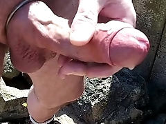 cock and balls affectation on the beach