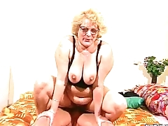 Granny gets their way hairy pussy dildoed increased by fucked