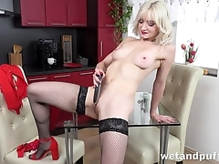 Sexy blonde in stockings pleases herself relating to dildo