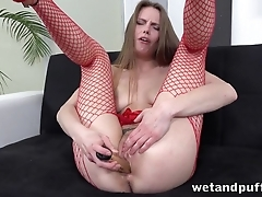Wet pussy of hottie in fishnets swallows long dildo