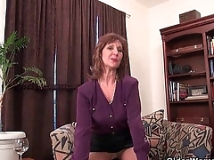 Granny Claire fucks herself at hand a dildo