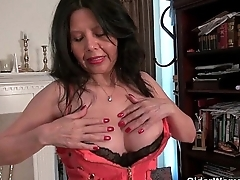 American granny April White works her old pussy up dildo
