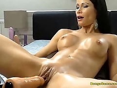 Brunette hottie enjoying her very waggish time with sex-machine and squirting