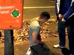 Pissing and self pissing next to busy street