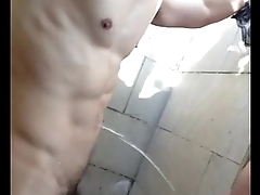 Piss shower daytime at the outdoor shower of gym