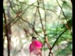 Desi woman in red takes a persevere b happen in the forest